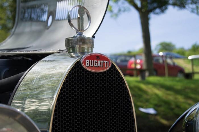 La Vie En Bleu 2013 Bugatti Badge 700x465 - La Vie En Bleu – A thoroughly French affair - La Vie En Bleu – A thoroughly French affair