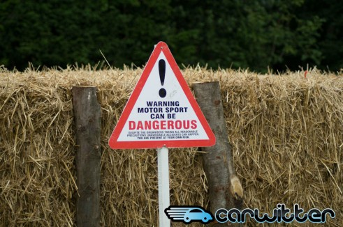 Warning Motorsport Can Be Dangerous  491x326 - Goodwood Festival of Speed 2013 - Review - Goodwood Festival of Speed 2013 - Review