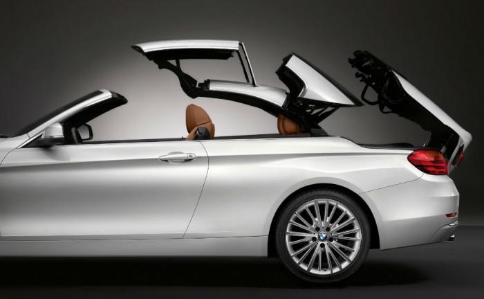 2014 BMW 4 Series Convertible Roof Retracting carwitter 700x432 - 2014 BMW 4 Series Convertible Price & Specs - 2014 BMW 4 Series Convertible Price & Specs