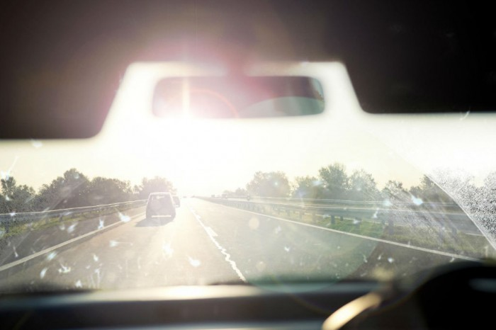 Windscreen Sun Dazzle carwitter 700x466 - The Pros And Cons Of Auto Glass Replacement Vs Repair - The Pros And Cons Of Auto Glass Replacement Vs Repair