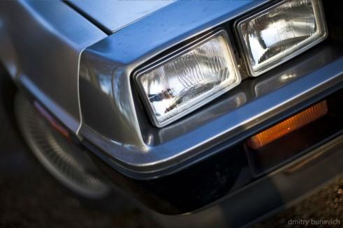 Delorean DMC 12 Headlight Detail carwitter 491x327 - Owning a DeLorean - Owning a DeLorean
