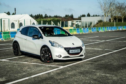 White Peugeot 208 GTI 30th Anniversary - Front Angle Dist - carwitter