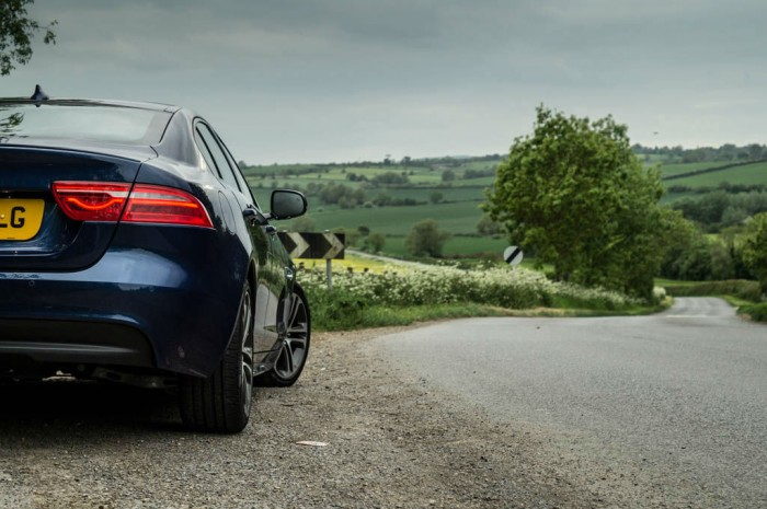 Jaguar XE Review UK First Drive Country Road Scene carwitter 700x465 - Why You Should Take A Road Trip Instead Of Flying - Why You Should Take A Road Trip Instead Of Flying