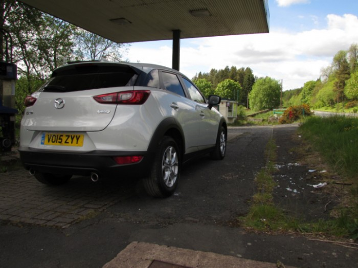 Mazda,CX3,2015,scenic,rear,side,Carwitter