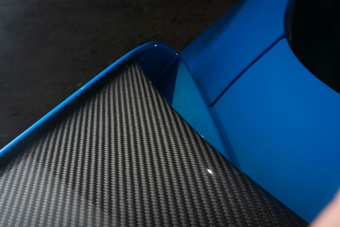 2014 Jaguar XFR-S Review - Rear Wing Carbon Detail - carwitter