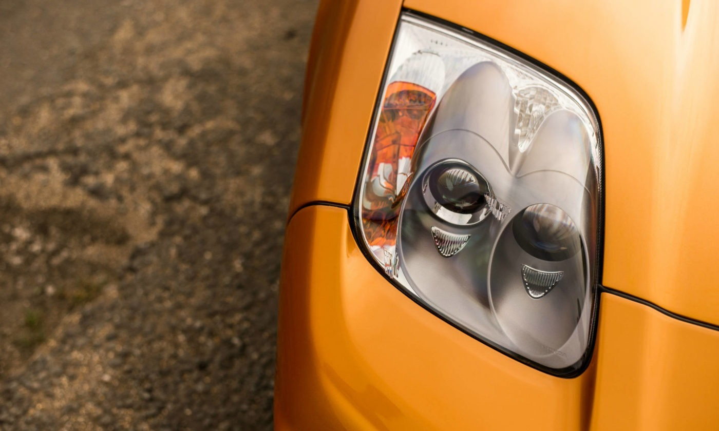 2005 Honda NSX Imola Orange Headlight carwitter 1400x840 - The history of headlights - The history of headlights