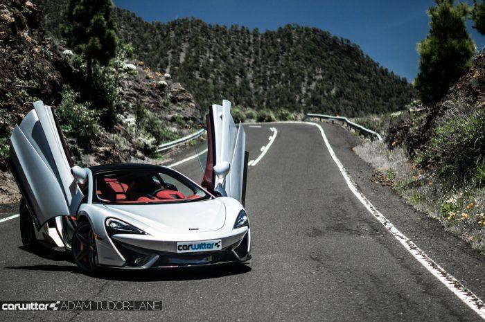 McLaren 570GT Review - Doors Up Scene Side - carwitter