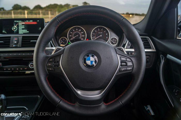 2016-bmw-330e-edrive-review-steering-wheel-carwitter