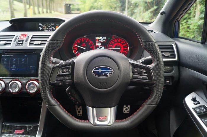 2016 Subaru WRX STi Review Steering Wheel carwitter 700x465 - Subaru WRX STi 2016 Review - Subaru WRX STi 2016 Review