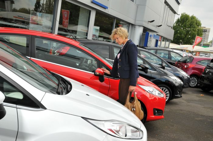 New Car Customer Forecourt carwitter 700x465 - So, You've Bought A Car. Now What? - So, You've Bought A Car. Now What?