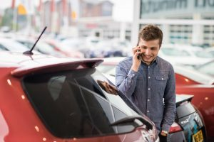 Buying a used car young man carwitter 300x200 - Does car insurance drop when you turn 25? - Does car insurance drop when you turn 25?