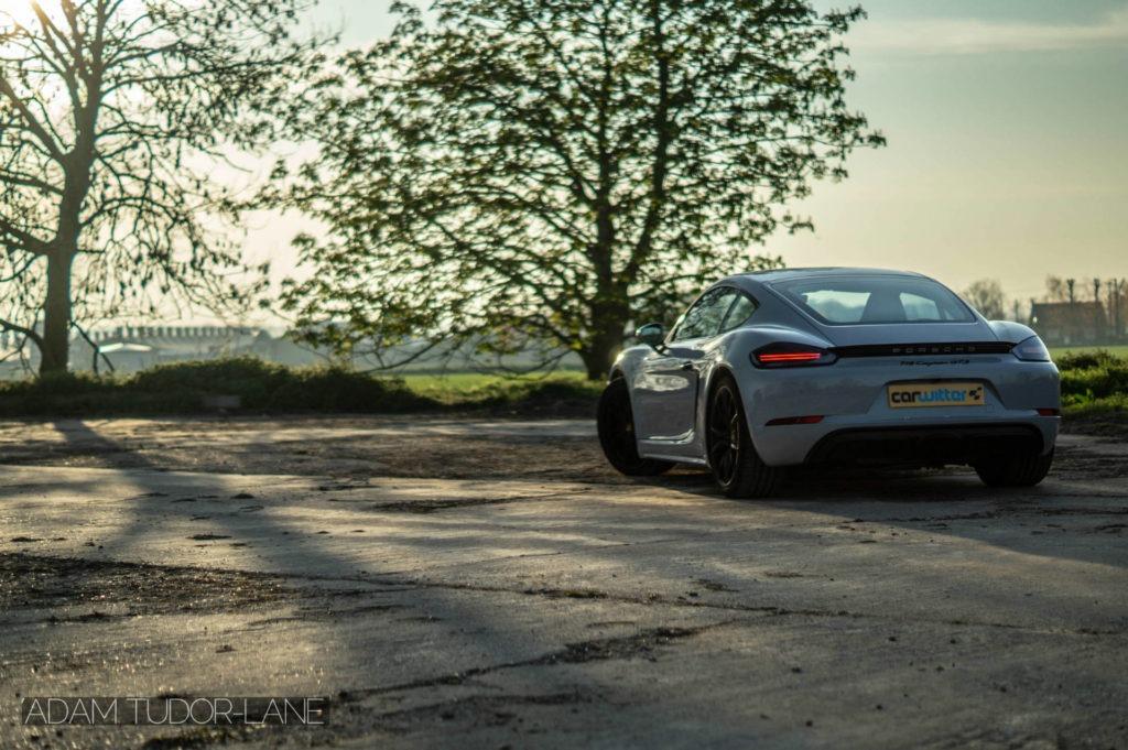 2019 Porsche 718 Cayman GTS Rear Angle carwitter 1024x681 - 2019 Porsche Cayman 718 GTS Review - 2019 Porsche Cayman 718 GTS Review