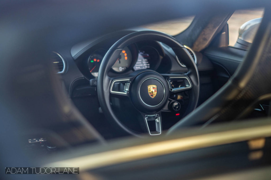 2019 Porsche 718 Cayman GTS Steering Wheel Detail carwitter 1024x681 - 2019 Porsche Cayman 718 GTS Review - 2019 Porsche Cayman 718 GTS Review